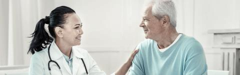 healthcare provider and patient sitting at a table talking